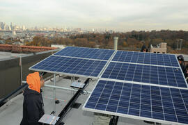 Workers installing rooftop solar panels at Sun Garden Homes co-op, Sunset Park, Brooklyn